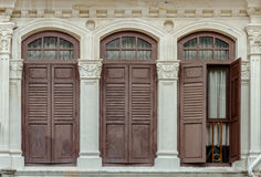 Window and the door of old buildings on background. Royalty Free Stock Image