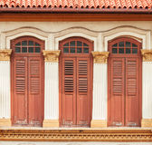 Window and the door of old buildings on background. Stock Image