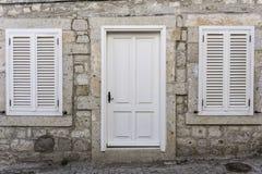 Window and Door. On Stone Wall Stock Photos