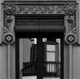 Window with dragons. Shot in black and white. Placed on the facade of this historic building , sculpture around the window representing a pair of dragons. Set in Royalty Free Stock Photos