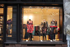Window with dressed mannequins Royalty Free Stock Photo