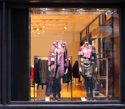 Window with dressed mannequins Stock Image