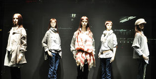 Window dressing. Mannequins displaying clothes in a store window Stock Photo