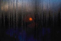 Window drops of rain sunset of the sun scenes landscape stock image