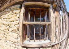 Window - an element of the stone-wooden architecture of the mountain village of Zheravna in Bulgaria. Mountain eco-village Zheravna - Bulgarian national carpet stock photos