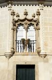 Window from Evora, Alentejo, Portugal. Detail of the typical architecture of Evora, Portuguese world heritage city by Unesco, rich in palaces and stately homes stock photography