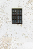 Window on the facade of an abandoned white house Royalty Free Stock Image