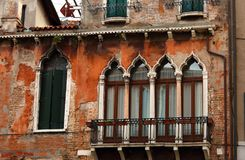 Window facade with balcony of old house in Italy Venice historic Royalty Free Stock Photo