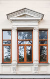 Window on the facade of the old architectural building with arch.  Stock Images