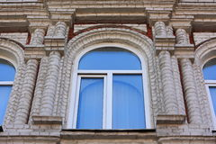 Window on the facade of a old building. Vintage architecture. Old building and modern window Stock Photography