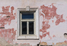 Window and a facade of an old house Stock Photo