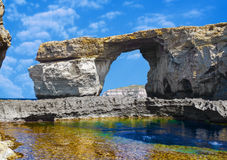 Window, famous stone arch of Gozo island in the sun in summer, Malta Royalty Free Stock Photo