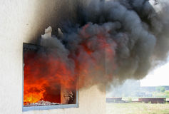 Window on Fire. Photo of huge flame distracting house on fire. Fire safety concept Royalty Free Stock Photo