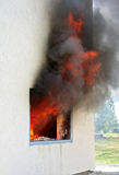 Window on Fire. Photo of huge flame distracting house on fire. Fire safety concept Royalty Free Stock Photos