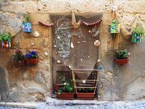 WOODEN DOOR WITH FISHING NET AND FLOWERS, ALGHERO, SARDINIA, ITALY Stock Photos