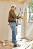 Window fitter at woodhouse. Window fitter working at woodhouse Royalty Free Stock Images