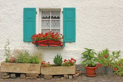 Window with floral decorations. Decorative wooden window with floral decorations in Monreal, Eifel, Rhineland-Palatinate, Germany Royalty Free Stock Images