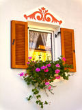 Window with Flower Box. Decorated window with flower box Stock Photography