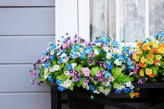 Window and flower box. European-style houses Stock Images