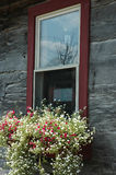 Window Flower Box. Window of country home with flower planter box royalty free stock photography