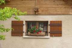 Window with flower box in France. Window and flower box with red geranium in France Royalty Free Stock Images