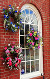 Window of a Flower Shop. Flower shop display of wreaths stock photo