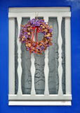 Window with flower wreath Stock Photography