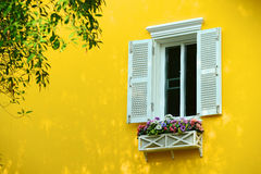 Window with flowerbox Royalty Free Stock Photos