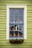 Window with flowerpots Royalty Free Stock Photo