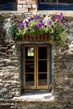 Window with flowers. Window of the old house in Arrowtown, Central Otago, New Zealand royalty free stock photography