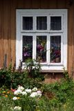 Window with flowers. Window in an old countryside house with flowers Royalty Free Stock Photo