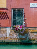 Window with Flowers Along Canal in Venice Royalty Free Stock Photos