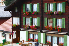 Window flowers on the building in Wengen,Switzerland Stock Photo