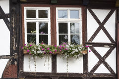 Window with flowers on a half-timbered house, Royalty Free Stock Image