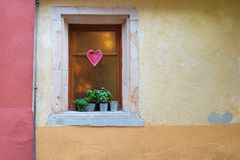Window with flowers and heart shape. Celebrating Valentines day. Vintage house detail Stock Image