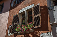 Window and flowers in an old building at Annecy. Window and flowers in an old building at the historical city center of Annecy. Located in the department of Royalty Free Stock Images