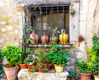 Window with flowers. Flowers and plants in a window in Italy Stock Photos