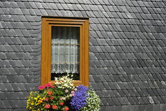 Window with Flowers in a Slate Wall Stock Images
