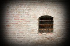 Window on fortress exterior wall Stock Image