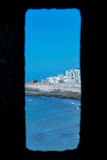 Window in the fortress. Little trip to Essaouira. Morocco stock photo