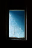Window frame. A window opening showing blue color wall stock photos