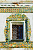 Window framed with colorful ancient mosaic tiles. Nicholas Vyazhischsky stauropegic monastery,Veliky Novgorod, Russia. Royalty Free Stock Image