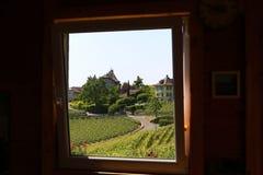 Window-framed view of Lavaux vineyards on Lake Geneva, Switzerland Royalty Free Stock Photo
