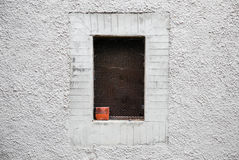 Window framed in whitewashed wall of alley in a village, Tuscany Alps Royalty Free Stock Photo