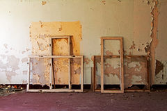 Window frames in old and abandoned room Stock Images