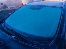 Window frost. On a car on cold and foggy winter morning Stock Photos