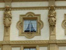 Window of the gallery of Milan, surrounded by two statues of antiques men in Milan in Italy. Stock Photo
