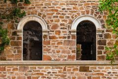 Window gaps on facade of abandoned mansion Dacha Kvitko. Two window gaps on the stone facade of the abandoned old mansion called Dacha Kvitko, Sochi, Russia royalty free stock photo