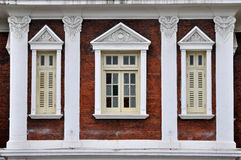 Window in geometric and symmetrical layout. White decorative window in geometric and symmetrical layout, shown as featured architecture element detail and Royalty Free Stock Images