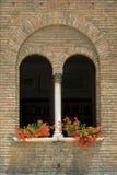 Window geraniums royalty free stock image